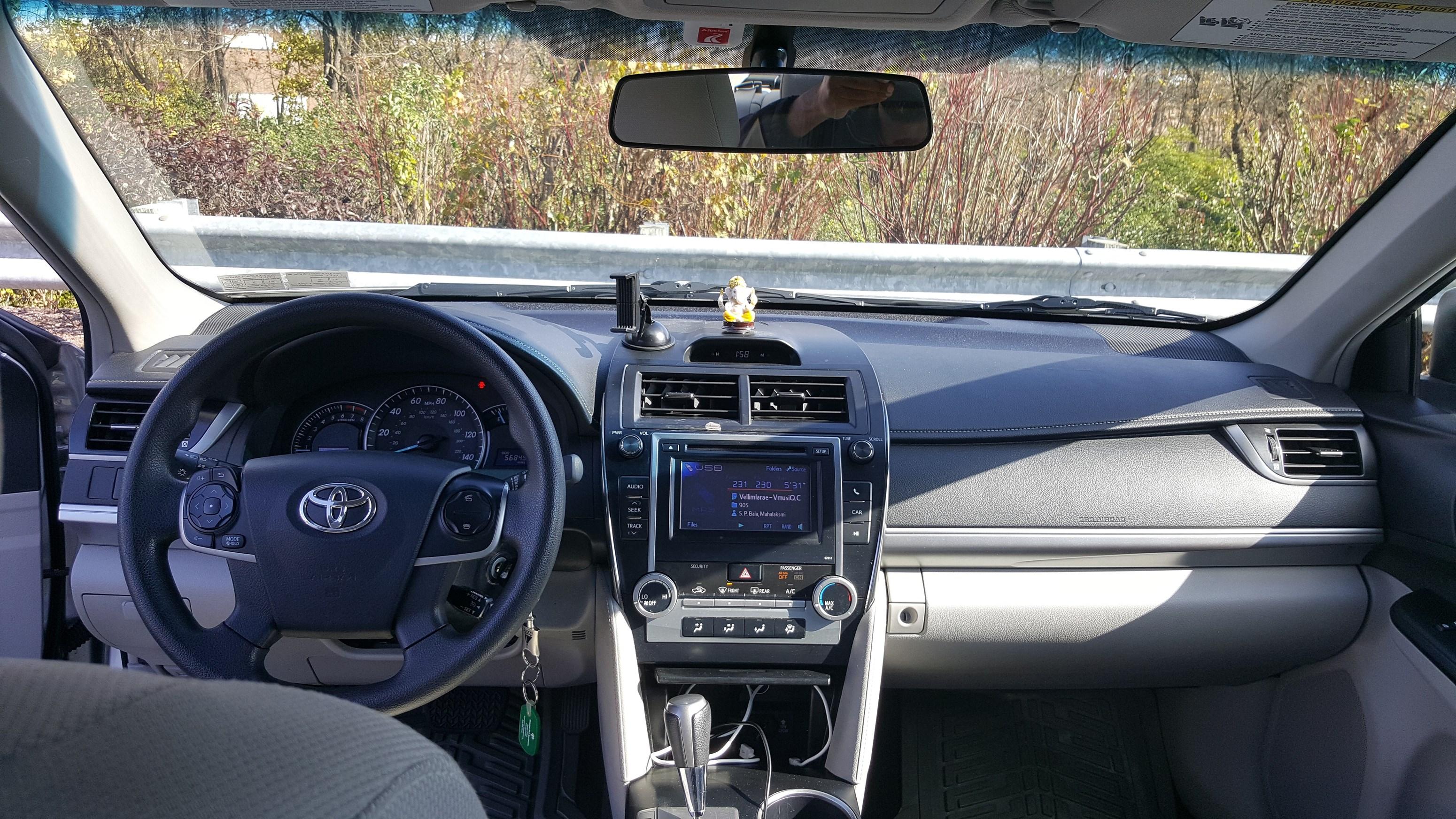 2012 toyota camry le 4 door 57k miles 11000